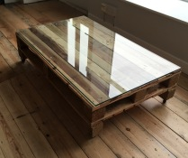 Wood pallet coffee table with glass top
