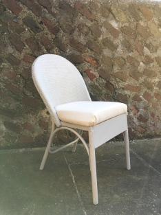 Salvaged and reupholstered wicker chair